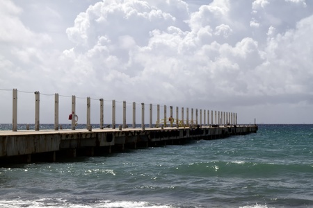 A long pier going out in the tropical ocean Stock Photo - 13517057