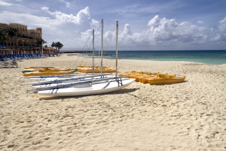 A group of personal sail boats on the beach by the ocean Stock Photo - 13707997