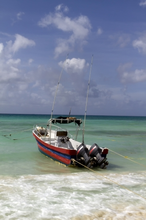 A boat ready to go out to sea by the beach Stock Photo - 13707987