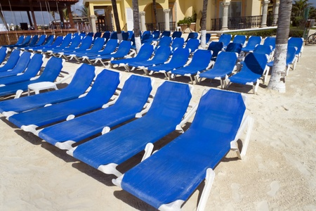 Rows of blue several lounge chairs on the beach Stock Photo - 13707996