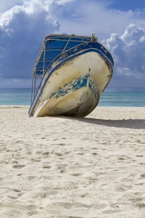 beached: A beached boat waiting for high tided Stock Photo