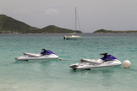 Two jet skies tied up in the Caribbean Sea Stock Photo