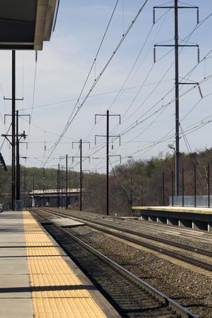 Empty electric rail road train tracks and platform