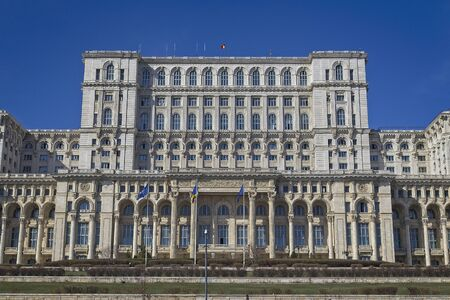 BUCHAREST, ROMANIA - MARCH 7, 2017: Palace of the Parliament which was started under Communist leader, Nicolae Ceausescu and is one of the largest administrative building in the world. Standard-Bild - 139769299