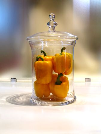Decorative glass vase of yellow bell peppers. Useful for kitchen decorations, diet, health care, photo