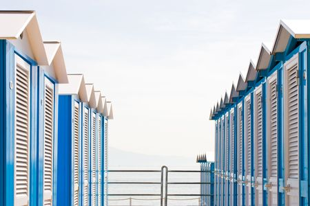 Rows of  typical italian  blue and white wooden beach huts. Photo taken at Arenzano, Liguria, Italy. Stock Photo