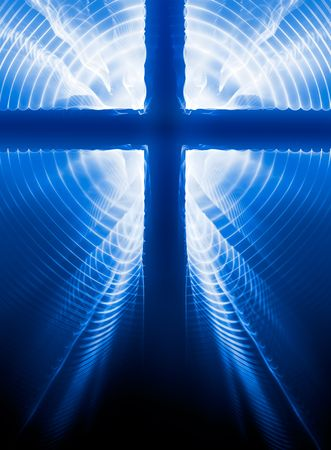 Easter crucifix silhouette on blue background with light rays from the back. Stock Photo