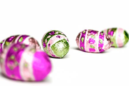 Easter chocolate eggs isolated on white.
