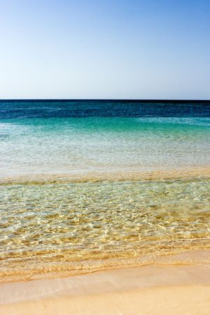 ionio: Landscape of the sea and the beach in a clear summer day. Christal waves are gently lapping the sand. Relax, vacation concept. Stock Photo