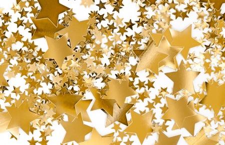 Golden stars on white background. Holidyay, Christmas, joy concept. Useful as seasonal greetings. photo