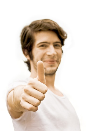 Young happy man is showing his hand with the thumb up  Success, positive concept  Isolated on white background Stock Photo - 15785856