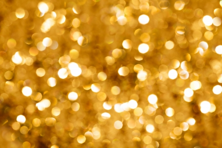 Gold blurred light.  Useful as Christmas background or greeting card. photo