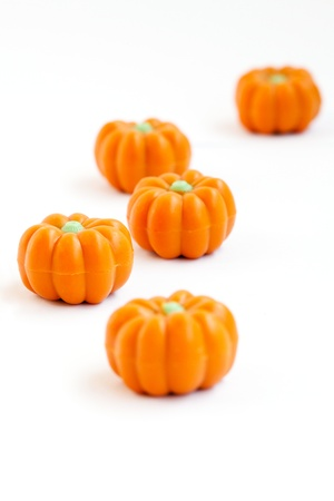 Colorful group of halloween candy in shape of pumpkins on white background  Also useful as autumn concept
