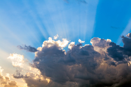 spirituality: Sun rays behind the clouds in the blue sky. Religion and spirituality concept too.