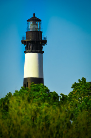 Bodie Lighthouse over the trees Stock Photo