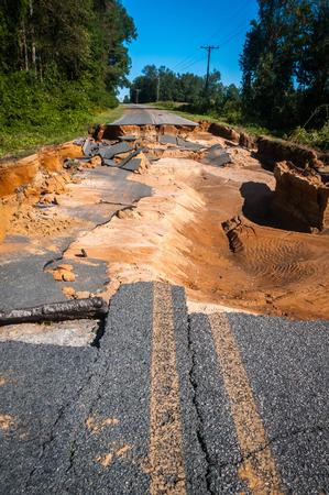 run down: A broken road due to a hurricane