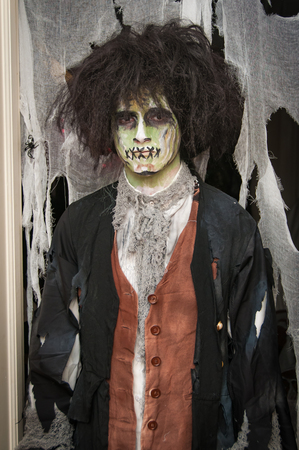 A man dressed as a zombie
