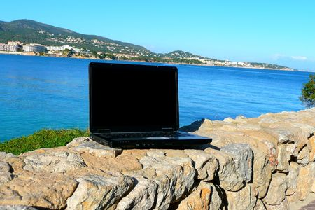 EASE: Laptop with sea view background