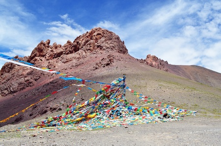 Rugged mountain against a blue sky, colorul prayer flags,Tibet,china