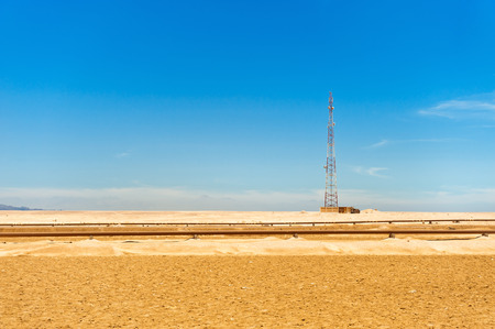 Telecommunications tower and oil pipeline in the Sahara desert, Egypt photo