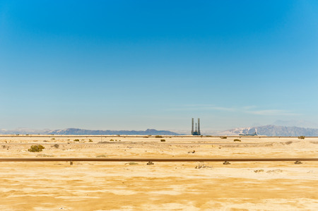 oil pipeline and oil rig in the Sahara desert, Egypt photo