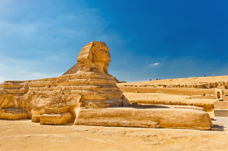 The Sphinx with Pyramid in background, Egypt Cairo