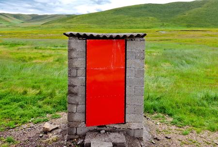 latrine: squat toilet in the grassland