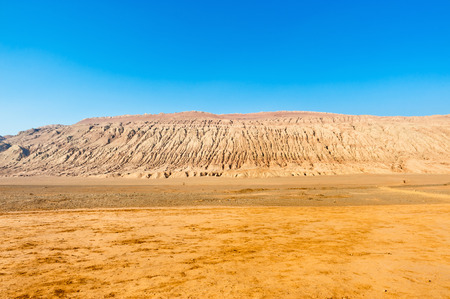 The Flaming Mountains are barren, eroded, red sandstone hills in Tian Shan Mountain range, Xinjiang, China  Imagens