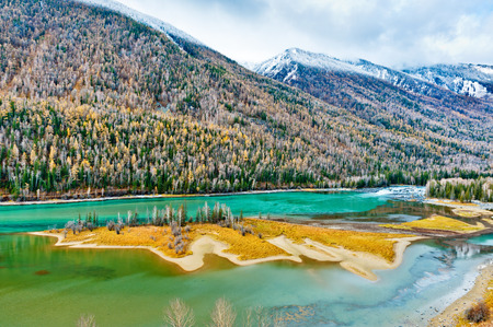 Kanas Lake in Altay Prefecture, Xinjiang, China  The lake is located in a valley in the Altai Mountains