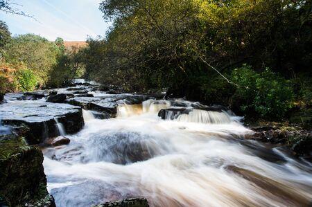 Scenic shot of small waterfalls on River Avon, Shipley Bridge, Avon Dam Reservoir, South Brent, Dartmoor Park