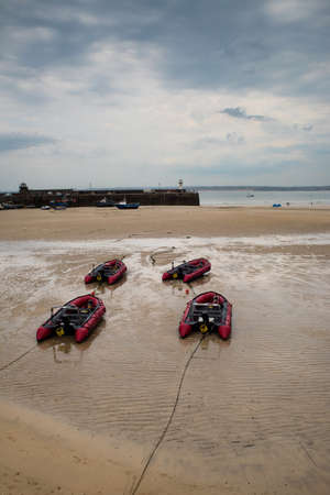 View of boats in St. Ives beach at low tide in Cornwall in England Фото со стока