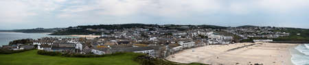 Panorama of Porthmeor Beach in St. Ives at low tide in Cornwall in England. Фото со стока