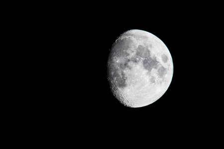 Half moon in the black sky. Фото со стока