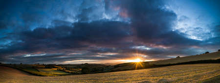 The colors of the sunset. Panorama of Labrador Bay in Devon in England.