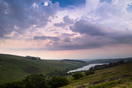 The colors of sunset sky before the storm. View of Cray Reservoir in Brecon Beacons National Park in Wales.
