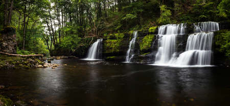 Sgwd y Pannwr WATERFALL in Brecon Beacons National Park in Wales. Фото со стока