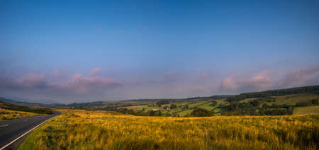 The colors of the sunrise. Panorama of Brecon Beacons National Park in Wales. Фото со стока