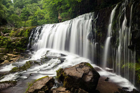 Sgwd Isaf Clun-Gwyn WATERFALL in Brecon Beacons National Park in Wales.