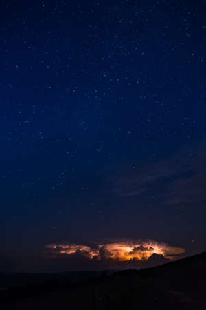 Stars and thunderbolts on night sky in Brecon Beacons National Park in Wales.