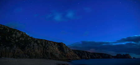 Night of stars on Porthcurno Beach - Lands End in Cornwall in England