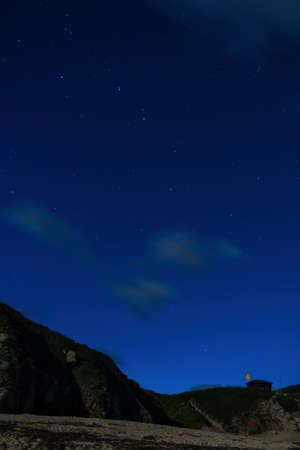 NIGHT of STARS - Big Dipper from the Porthcurno Beach in Cornwall Фото со стока