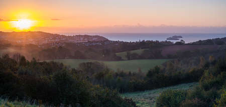 Sunrise over the Torquay fields in Devon in England in Europe.