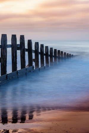 Sunrise on the beach at Dawlish Warren in Devon in England in Europe.