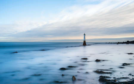 Long time exposure of Lighthouse in High Tide in Shaldon in Devon in England, UK, Europe
