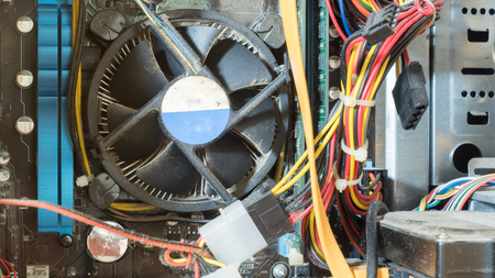inside a high performance computer. Old Computer circuit board and CPU cooling fans  inside hardware. Stock Photo