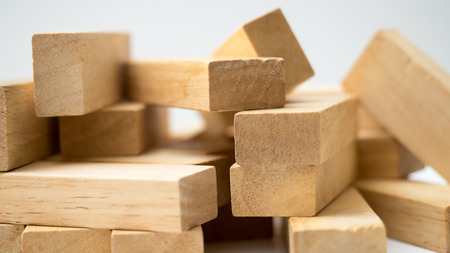 Wooden Blocks disrupted close up on white background