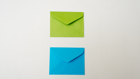pouch: A small envelope blue and green on white background