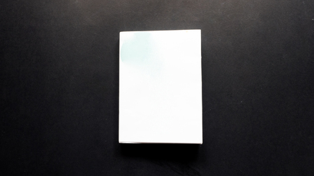 paper sheet: book on black background