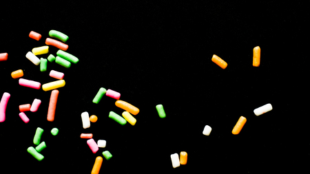 rainbow candy colorful black background Reklamní fotografie