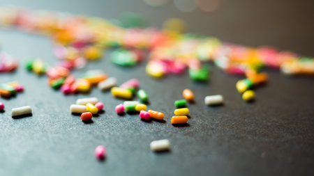 rainbow candy colorful black background Stock Photo